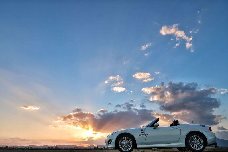 秋空 🍁🍂autumn 太陽 秋 夕陽 夕焼け 空 マツダ ロードスター Mazda MX-5 Miata Sky Car Transportation Exploding Cloud - Sky Sunset Sunlight Galaxy Autumn EyeEmNewHere Beauty In Nature Beautiful Nature EyeEm Nature Lover