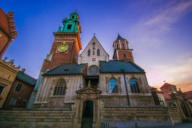 View of the Royal Archcathedral Basilica of Saints Stanislaus and Wenceslaus on the Wawel Hill also known as the Wawel Cathedral at sunrise in Krakow, Poland Wawel  Wawel Castle Cathedral Basilica Church Poland Sunrise Sunrise_sunsets_aroundworld Religion Religious  Roman Catholic Monument Saints Stanislaus And Wenceslaus Stanislaus Wenceslaus Saint Attraction Worship Travel Destinations Travel Tourism Urban Skyline Romantic Sky Staircase Clock Clock Tower Beauty Famous Place Building Exterior Built Structure Architecture Place Of Worship Building Belief Spirituality Low Angle View Sky The Past Tower History City No People Outdoors