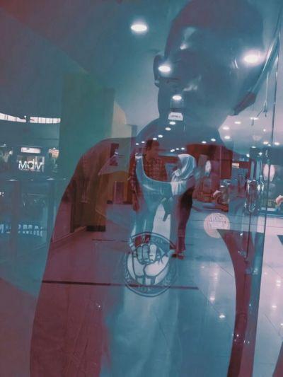 Digital composite image of man with illuminated lights