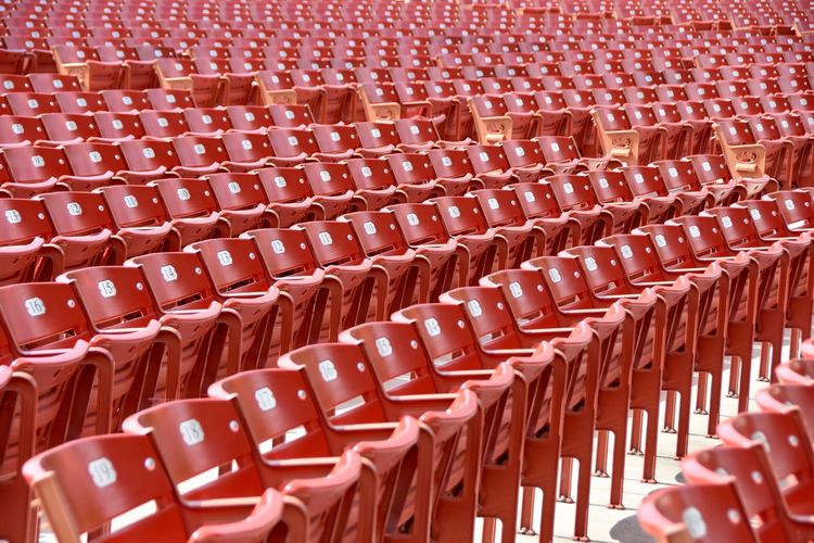 In A Row Red Stadium Standing Abundance Audience Auditorium Backgrounds Conformity Day Diminishing Perspective Empty Full Frame In A Row Indoors  No People Parallel Patterm Plastic Red Seat Side By Side Symmetry