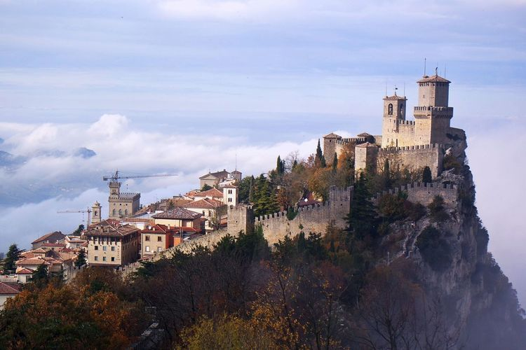 Architecture Building Exterior Built Structure City Medieval Mountain No People San Marino Sky Tower Travel Destinations Tree