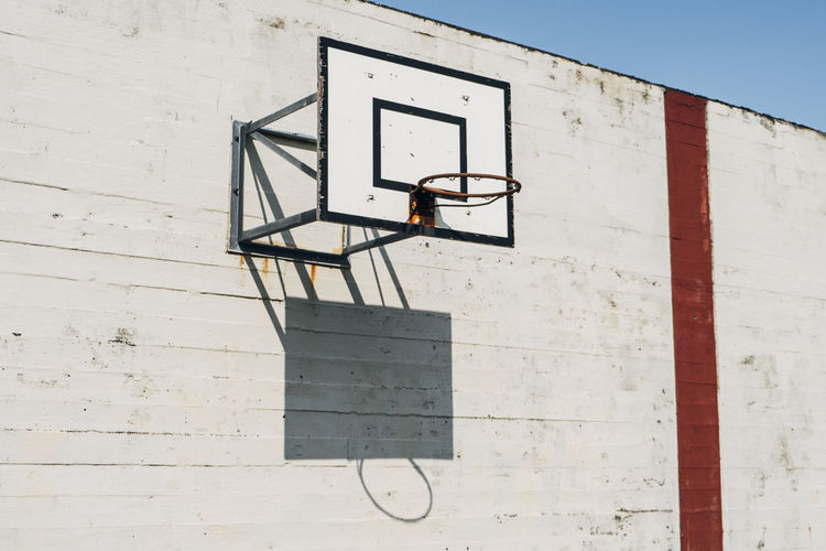 Low angle view of basketball hoop on sunny day