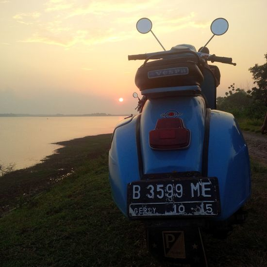 """enjoy time EyeEmNewHere EyeEm Selects Vespa Piaggio Vespa Piaggio Piaggiolovers Sunset Sunset_collection Beachphotography Beach Backgrounds Sunset_collection SundayFunday """"Keep Smiling, Because Life Is A Beautiful Thing And There's So Much To Smile About."""" ― Marilyn Monroe Sunset_captures Sunset View. Vespagram Vespa Indonesia Veszprém Vespamania Sunset Beach Sea No People Outdoors Sky Nature Water Beauty In Nature Day Vacations"""