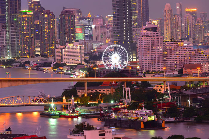 Taksin Bridge Chaopraya River, Bangkok Thailand Chowphaya River Landscape Transportation Bisness Thailand View Satron Bulding And Sky Skyscraper Night Building Exterior Architecture Urban Skyline Cityscape Illuminated Nightlife Neon River City Water Sky Downtown District Modern Stories From The City