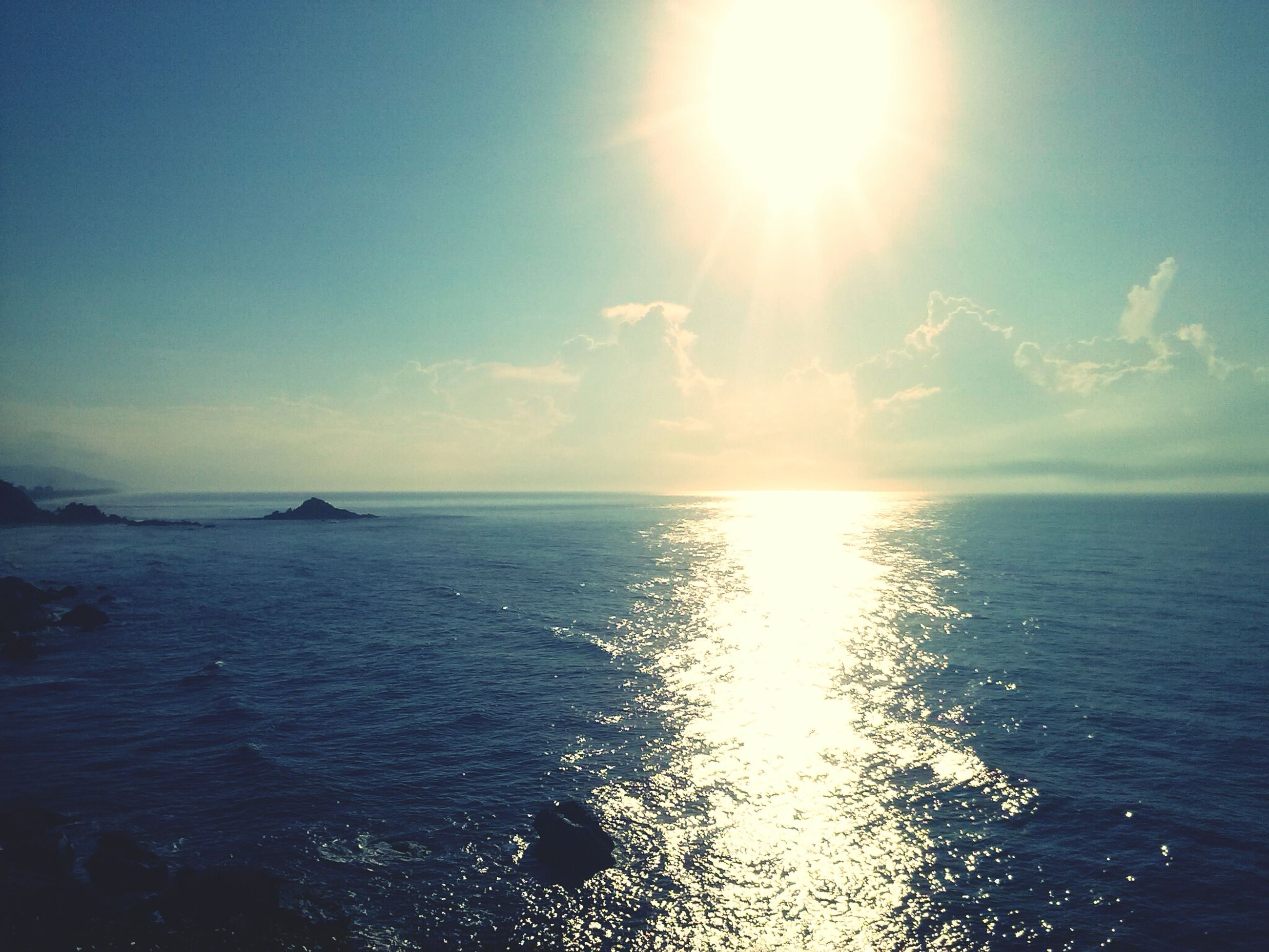 sea, horizon over water, water, tranquil scene, scenics, sun, sky, tranquility, beauty in nature, reflection, nature, sunlight, seascape, idyllic, waterfront, sunbeam, rippled, blue, cloud - sky, cloud