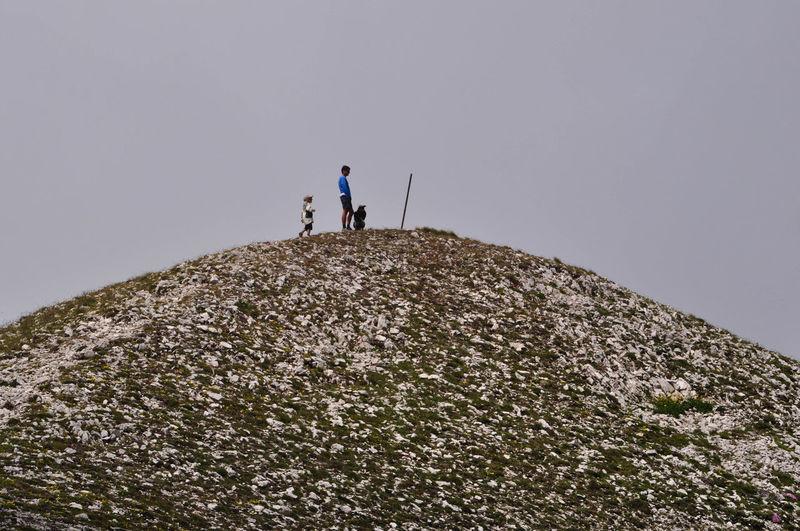 People walking on slope