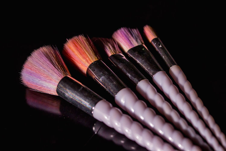 High angle view of colored pencils on table against black background