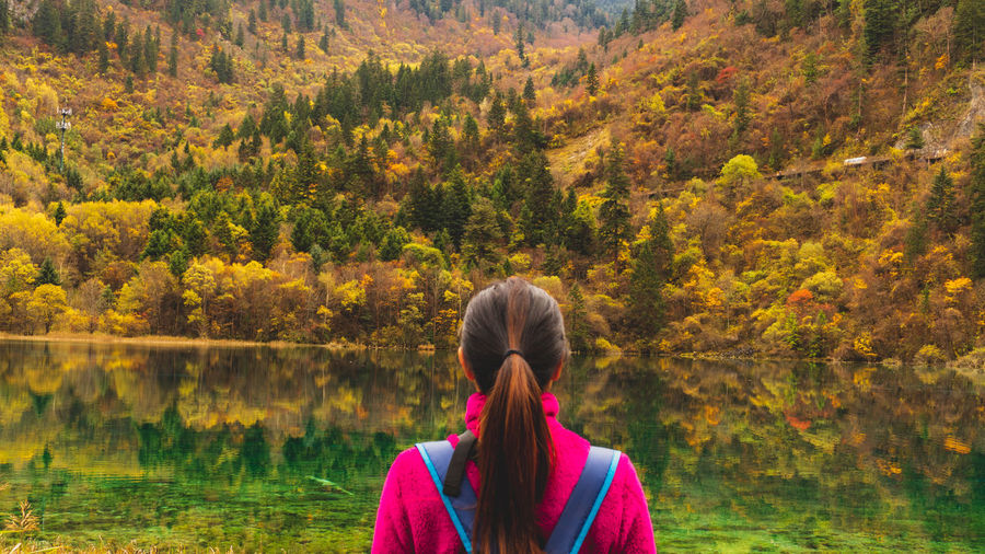 Autumn One Person Plant Tree Beauty In Nature Nature Women Change Real People Long Hair Headshot Rear View Adult Hairstyle Hair Day Leisure Activity Water Tranquility Lake Outdoors Autumn colors Autumn🍁🍁🍁