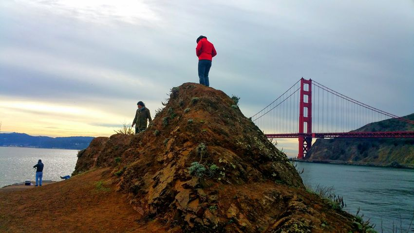 Scaling the Mound Golden Gate Bridge Background Copy Space Contemplating Zen Tranquil Scene Meditation Nirvana Distance Depth Brown Real People Multi Colored Outcropping Red Rock Rust Bluff Nature's Colors Bridge - Man Made Structure Sky Suspension Bridge Travel Destinations Cloud - Sky Adult Outdoors People Cityscape Architecture Standing EyeEm Ready