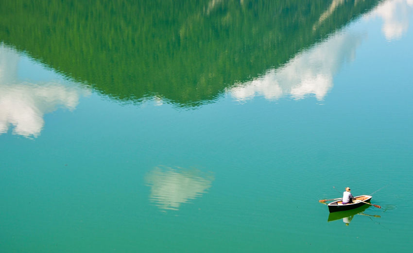 Austria Beauty In Nature Floating On Water Lake Mountain One Person Outdoors Reflection Rowboat Rowing Sylvensteinsee Transportation Water The Great Outdoors Live For The Story Breathing Space The Week On EyeEm