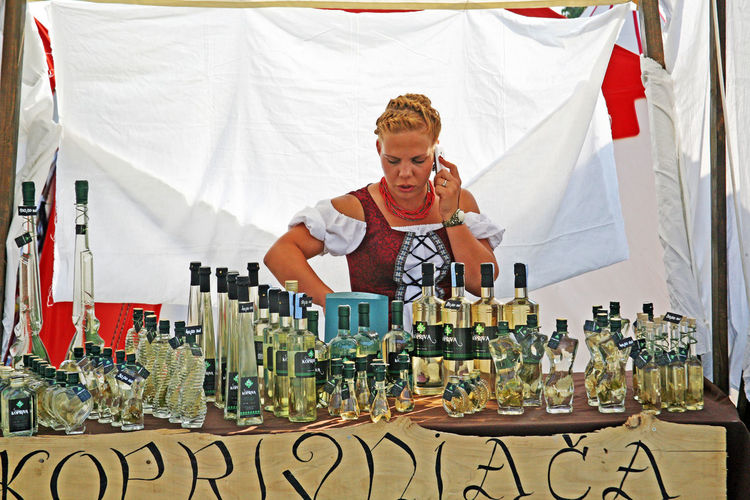 Renaissance Festival,Koprivnica ,Croatia,Europe,2016,contributor, 46 Contributors Craftmanship Croatia Day Eu Europe Fair Girl Interested? Koprivnica Lady Nettle Brandy Person Renaissance Festival Retail Display Selling Summer Traditional Young Adult
