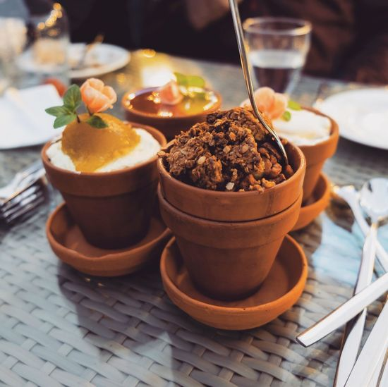 Close-up of dessert in containers on table at restaurant