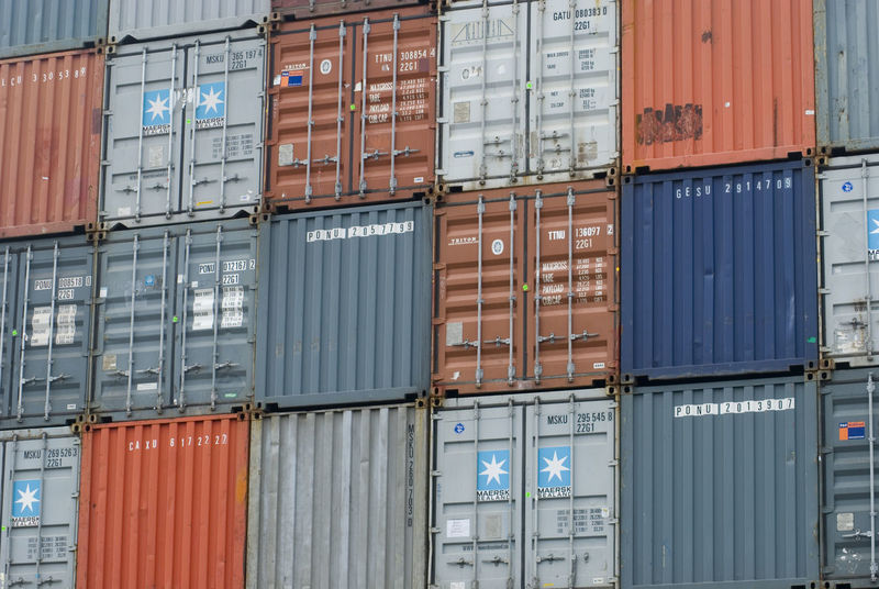 a stack of different coloured shipping contains Box Colour Container Lorry Move Moving No People Relocated Relocation Ship Shipping  Transportation Wagon