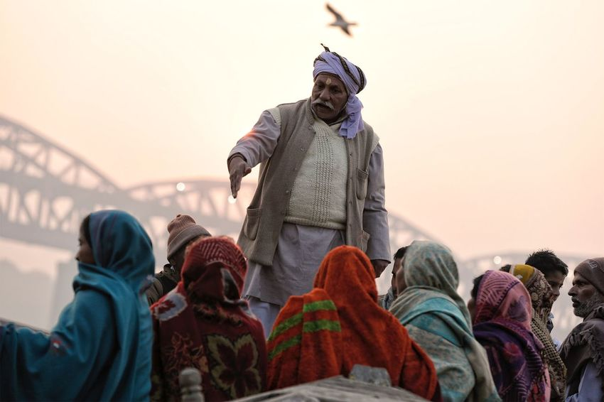 Ganges boat ride guide giving instructions. January 22, 2017. People Lifestyles Low Angle View Men Real People Human Representation India Ganges River Documentary Travel Destinations Storytelling Varanasi