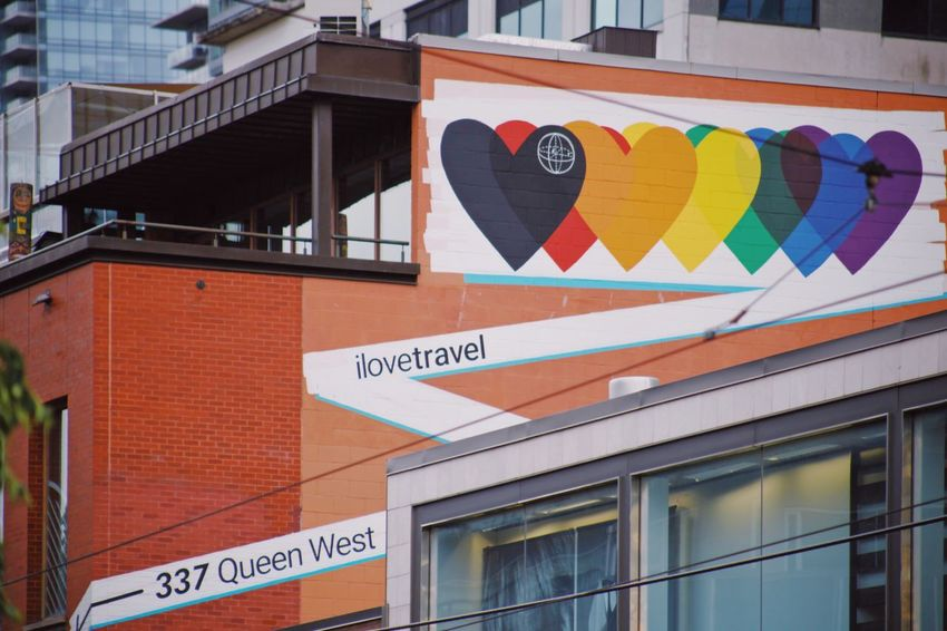 Pride week Toronto Open Edit Rainbow Rainbow Colors Art Graffiti Graphic Queen Street West Toronto Gay Pride Architecture Building Exterior Built Structure Communication Text No People This Is Queer Sign City Day Western Script Outdoors Multi Colored Building Window Low Angle View Symbol Orange Color Street Red Information