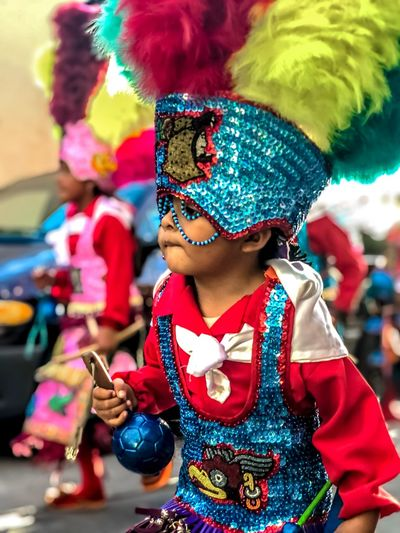 IPhone X Mobile Photography IPhone IPhoneography One Person Holding Real People Childhood Waist Up Multi Colored The Portraitist - 2019 EyeEm Awards Focus On Foreground Costume Child Women Celebration Clothing Lifestyles Leisure Activity Standing Innocence Obscured Face Looking Outdoors Girls