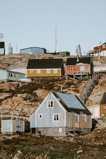 Remote Arctic settlement, Ittoqqortoormiit Ittoqqortoormiit Abode Architecture Arctic Building Building Exterior Built Structure City Clear Sky Community Copy Space Day Dwelling House Mountain Nature No People Nordic Outdoors Religion Residential District Roof Row House Scoresby Sound Scoresby Sund Sky Sunlight TOWNSCAPE Window