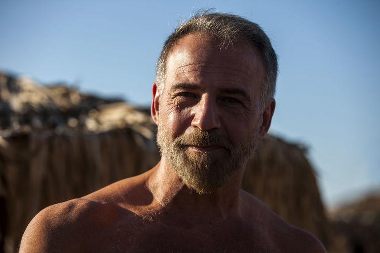Portrait of shirtless bearded mature man