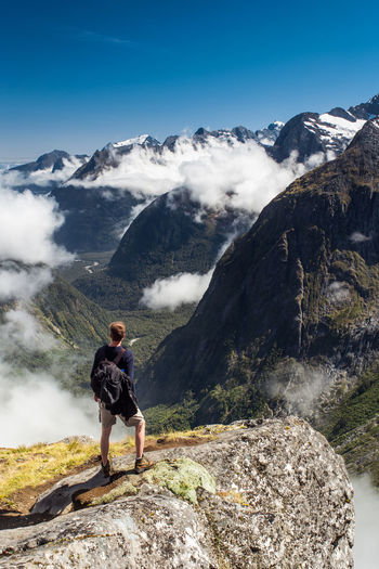 Rear view of man of man hiking in fiordland national park