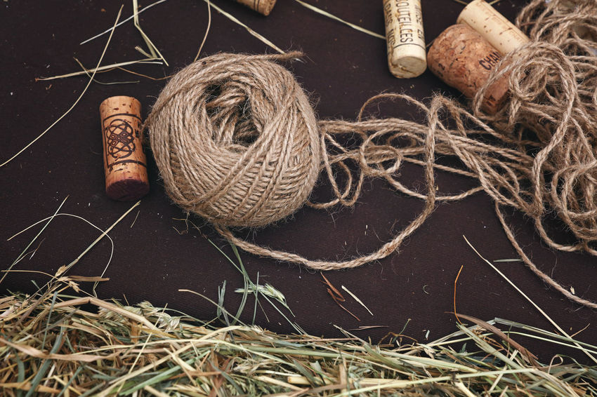 Vintage decorations with wine cork, hay Close-up Cork Decor Decoration Decorations Decorative Art Detail Details Hay High Angle View Jute No People Rustic Rustic Style Thread Vintage Wine Wine Moments Wine Not Wine Stoppers