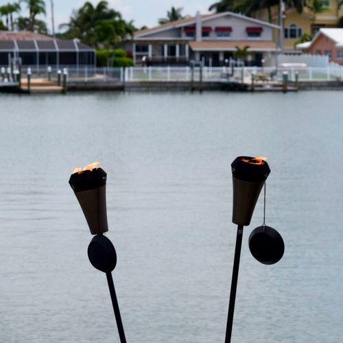 Flaming torches at resort by lake