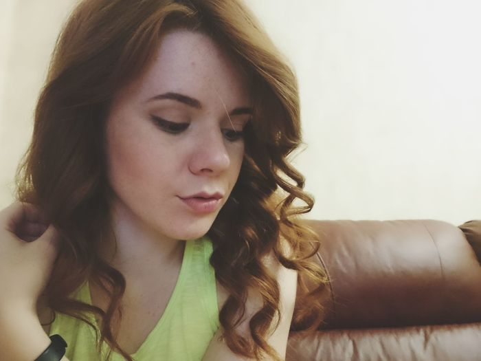 Close-up of young woman with eyes closed at home