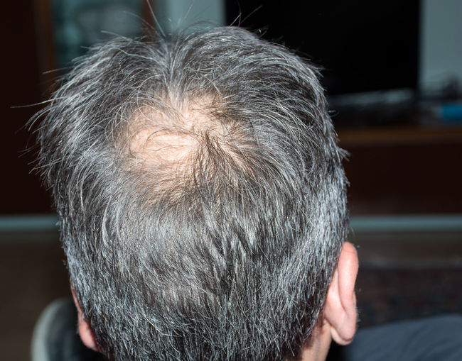 Rear view of mature man with gray hair