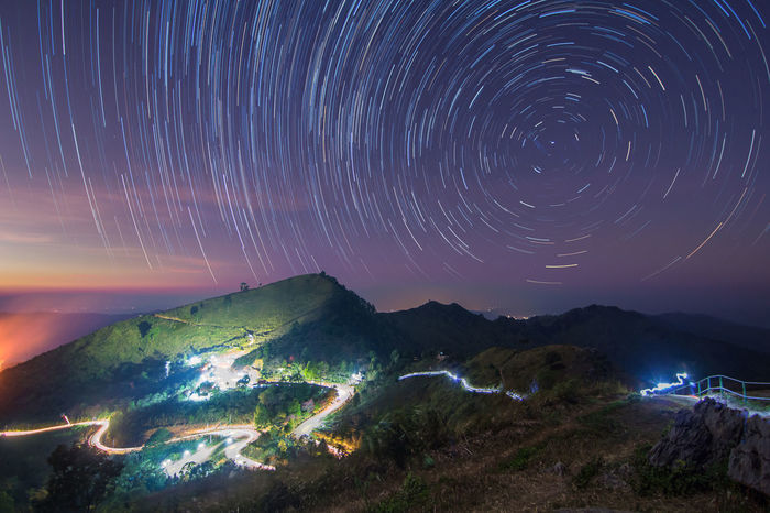 Chiang Rai, Thailand Astronomy Beauty In Nature Blurred Motion Constellation Doi Pha Tang Galaxy Illuminated Light Trail Long Exposure Motion Mountain Nature Night No People Outdoors Scenics Sky Space Star - Space Star Trail Star Trails Tranquil Scene Tranquility Water