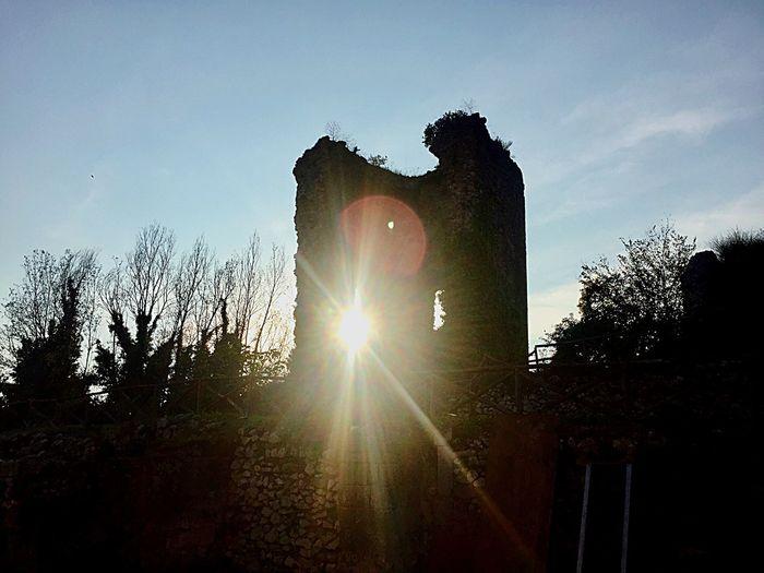 Sunshine through castle ruins Sky Tree Plant Nature Silhouette Lens Flare Sunlight Sunbeam No People Sun Sunset Outdoors Architecture Built Structure Back Lit Day