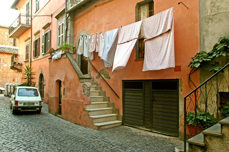 Car parked under the hanging clothes Pink Wall Stairs Building Exterior Car Car Parked Car Parked In Front Of Building Clothesline Hanging Hanging Clothes House Italy Lazio Outdoors Residential Building Street Via Amerina