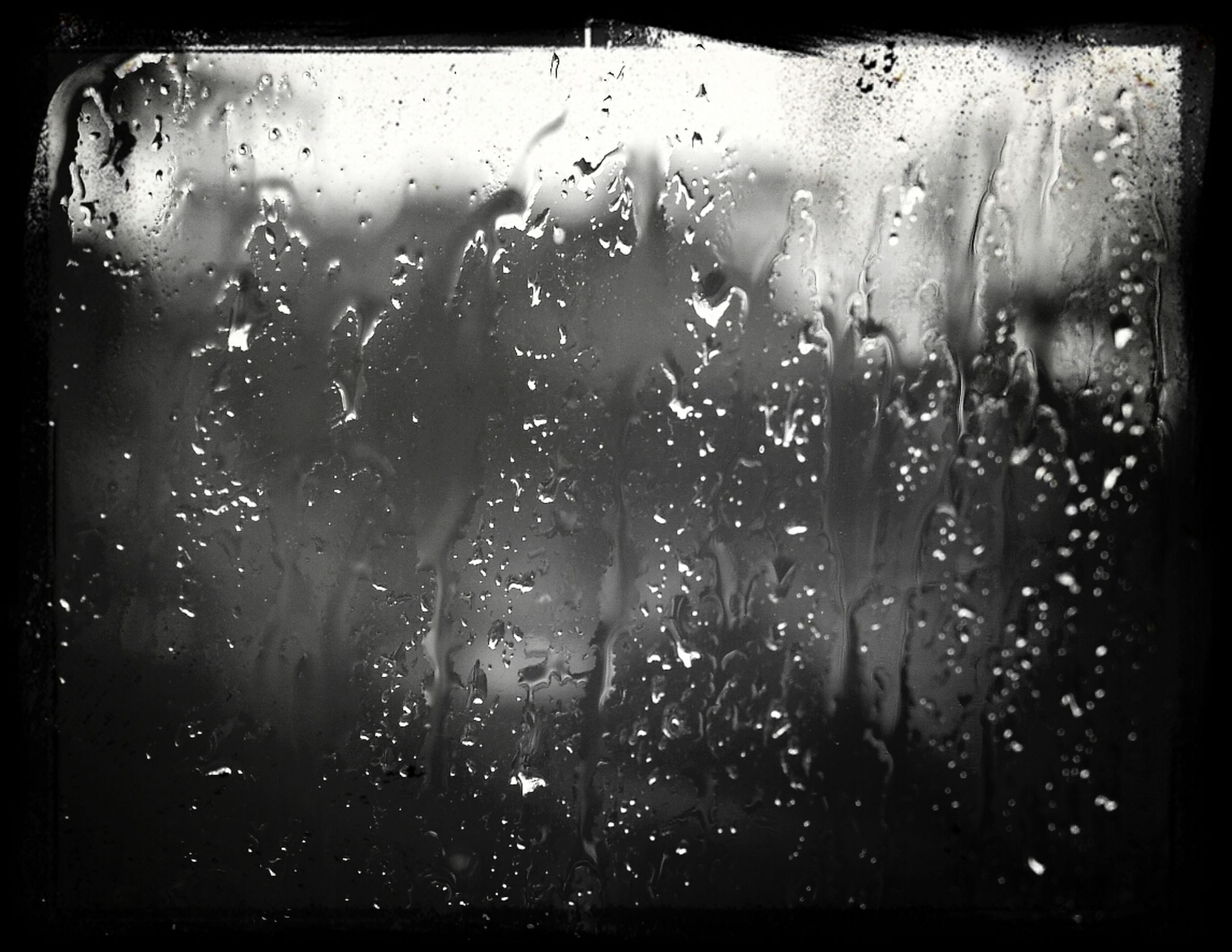 indoors, window, transparent, transfer print, glass - material, wet, rain, drop, auto post production filter, glass, vehicle interior, weather, lifestyles, men, water, full frame, silhouette, looking through window, raindrop