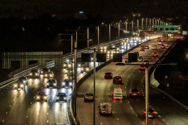 Winter night time at Essingeleden, Stockholm, Sweden. A highway with multiple lanes of traffic and many cars in both directions. Traffic moves both towards and away from the viewer. Illuminated Transportation Night Motor Vehicle Car Road City Mode Of Transportation Land Vehicle Street Architecture Motion on the move Built Structure Traffic High Angle View No People Connection Direction Highway Outdoors Multiple Lane Highway Essingeleden Cars Stockholm Sweden