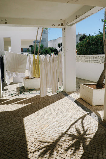 Architecture Chores Cleaning Clothesline Day Domestic Life Drying Exotic Freshness Hanging Laundry Nature No People Ocean Life Palm Tree Portrait Shadow Sheets Still Life Sunlight Towel Vacations Washing White White Sheets
