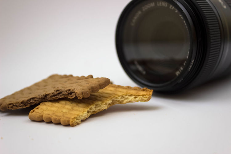 Black Color Brown Close-up Cookie Copy Space Cut Out Focus On Foreground Food Food And Drink Freshness Glass Glass - Material Indoors  Lens - Optical Instrument No People Photography Themes Selective Focus Snack Still Life Studio Shot Table Temptation White Background