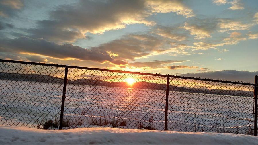 Snow covered landscape at dusk