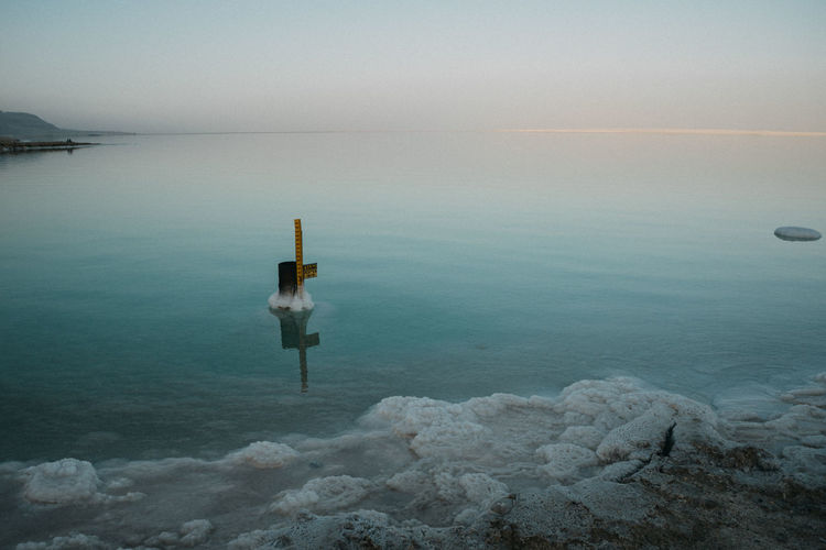 Scenic view of dead sea against sky