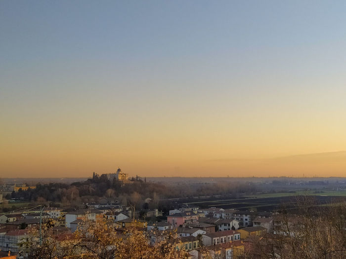 High angle view of townscape against clear sky during sunset