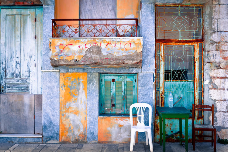 Urban Patchwork Architecture Chair Seat Built Structure No People Building Exterior Old Building Window Day Door Empty Entrance Weathered Abandoned Wall - Building Feature Absence Wall Wood - Material House Outdoors Brick Deterioration Ruined Urban Exploration My Best Photo