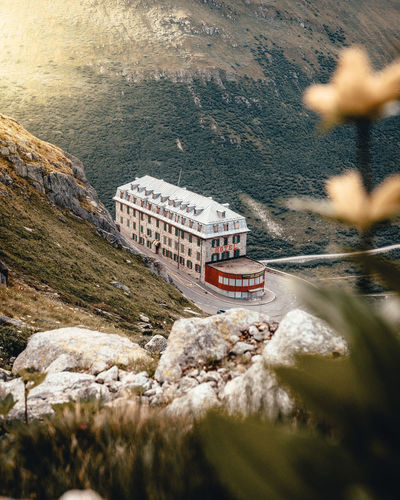 The famous abandoned Hotel Belvedere right at the Furkapass VS in Switzerland Furkapass Wallis Walliser Alpen Belvedere Switzerlandpictures Water Transportation Mode Of Transportation Rock Day Mountain High Angle View Beauty In Nature Rock - Object Nature Nautical Vessel No People Scenics - Nature Travel Motion Solid Selective Focus Architecture Outdoors