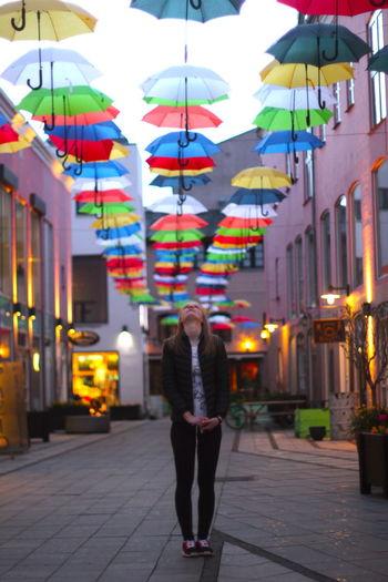 People holding umbrella at night