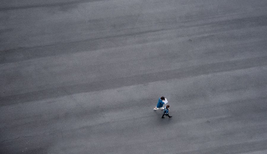 High Angle View Of Women Walking Road