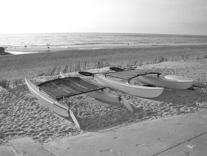 Abandoned catamarans on Sylt, Germany. Abandoned Blackandwhite Blackandwhite Photography Boat Eyeemblack&white Germany No People Sea View Seascape Seaside Sylt Sylt Strand Sylt, Germany Sylt_collection Tranquil Scene Tranquility Transparent Two Objects Working