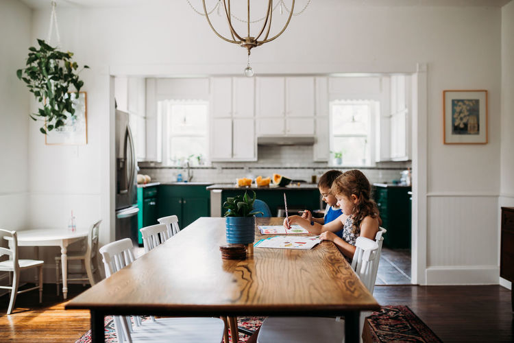 Boy sitting on table at home