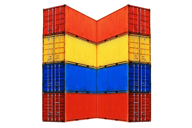 Ten differently colored sea containers stacked, isolated on white background. Architecture Blue Building Exterior Built Structure Cargo Construction Contaie Day No People Outdoors Red Shipping Containers White Background Yellow