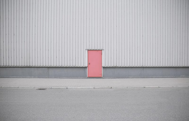 Red closed door of building