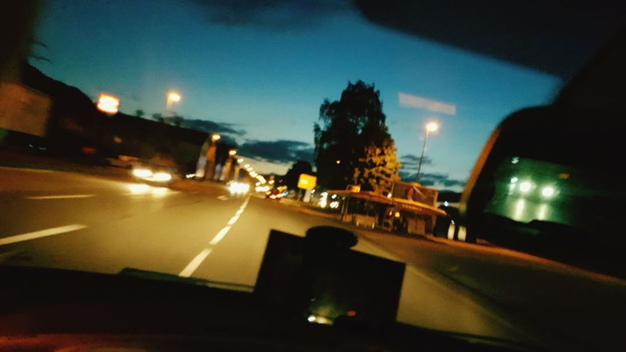 They see my drivin and i see them too Drivebyphotography Drive Driving Around Street Inside The Car Blurry But Oh Well Traffic Lights Public Area Town Evening Sky Nightphotography Blur Effect Riddle