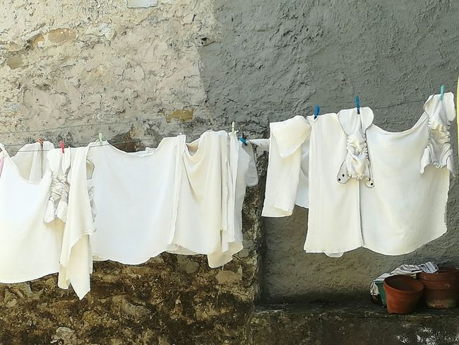 On The Line Hanging White Clothes Clean Outdoors No People Drying Clothes Same Colour