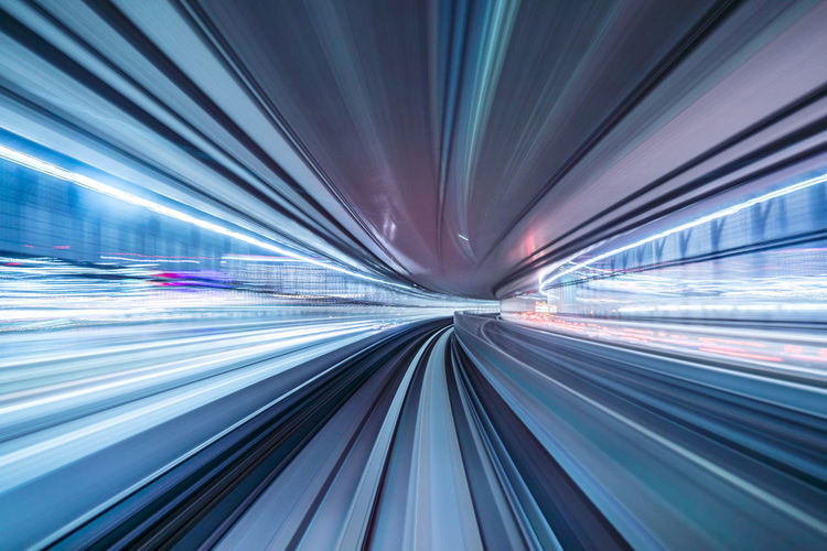 Long exposure image of illuminated road in city