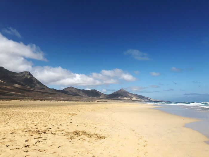 Volcano Mountain Beach Shore Fuerteventura Cofete Land Sky Beach Scenics - Nature Water Beauty In Nature Sea Tranquil Scene Sand Blue Nature Cloud - Sky Day Non-urban Scene Tranquility Mountain Idyllic No People Outdoors