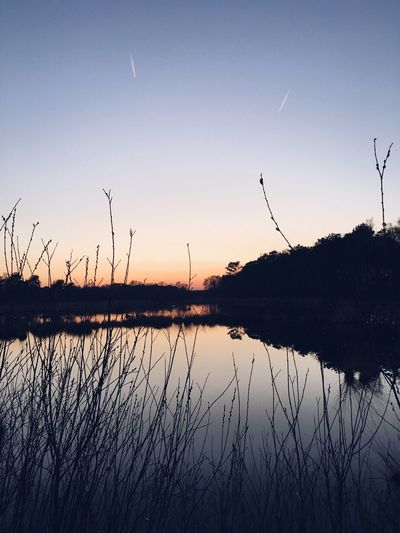 Reflection Lake Sunset Nature Beauty In Nature Scenics Silhouette Tranquil Scene Water Outdoors Tranquility No People Sky Plant Grass Day VSCO Backgrounds